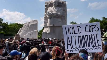 Demonstrators gather Thursday at the Martin Luther King