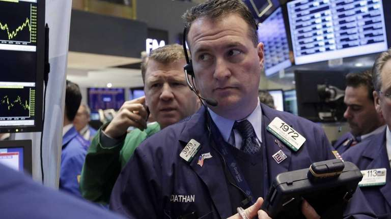 Trader Jonathan Corpina, right, works on the floor