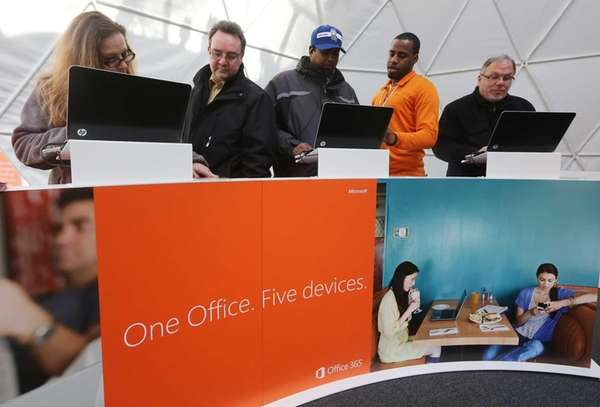 People try out devices at the Microsoft Office