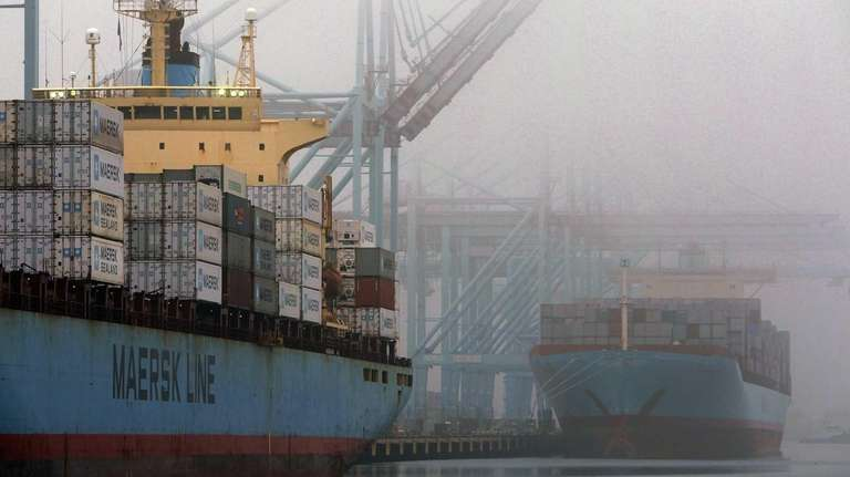 Cargo vessels disburse and take on containers late