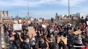 Protesters marched across the Brooklyn Bridge on Thursday,