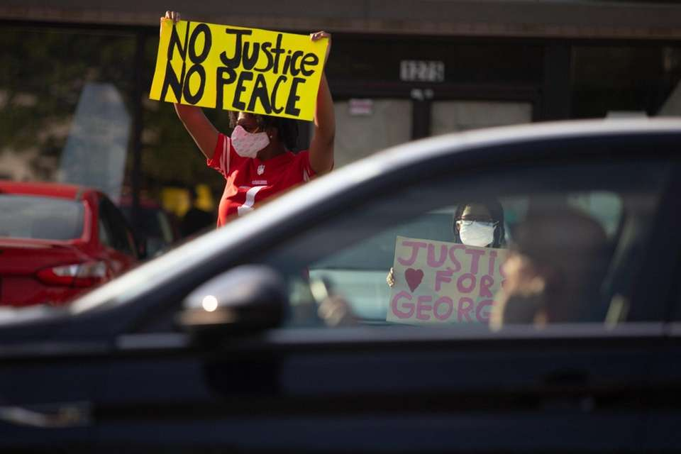Protesters gather on Front Street in Uniondale to