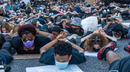 Hundreds of mostly young adults protested and marched