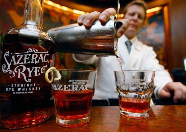 Bartender Timothy Worall prepares a Sazerac cocktail at