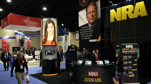 The National Rifle Association (NRA) booth is seen