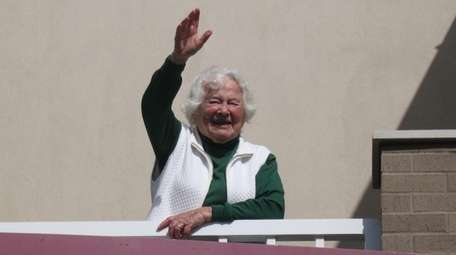 The writer's mother, Vivian Schachter, waves to son