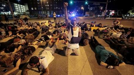Protesters lay in the middle of the intersection