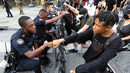 Atlanta Police Officer J. Coleman, left, and protester