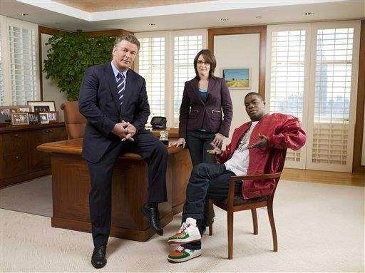 From left, Alec Baldwin as Jack Donaghy, Tina