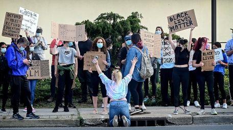 Black Lives Matter protestors gather during a peaceful