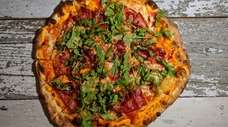 "The wood-fired, n'duja-topped ""Appetite for Destruction"" pie at"