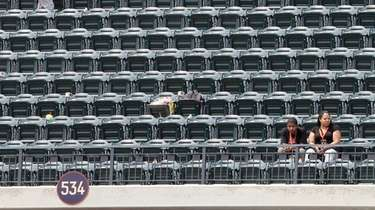 Empty seats are seen as the Mets play