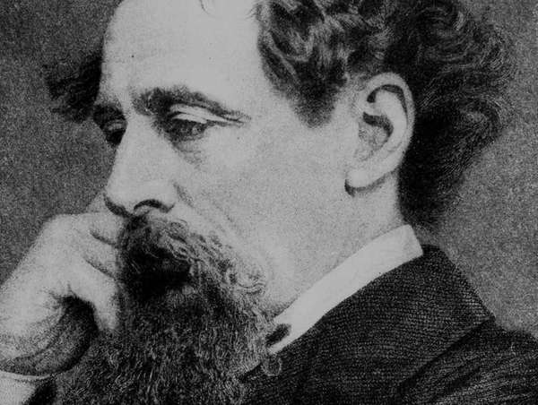 Charles Dickens sits in this 1861 photo engraved