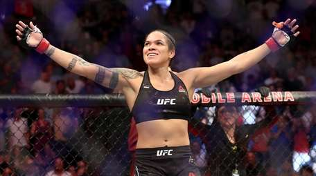 Champion Amanda Nunes reacts after defeating Holly Holm