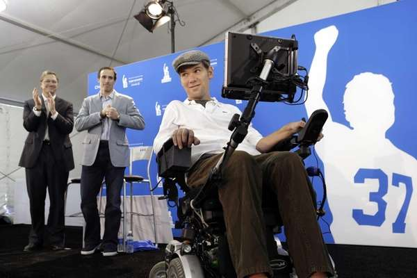 Steve Gleason, right, a former New Orleans Saints
