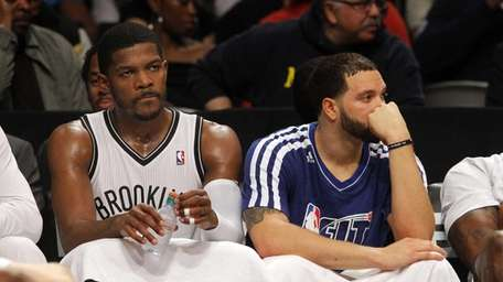 Joe Johnson #7 and Deron Williams #8 look