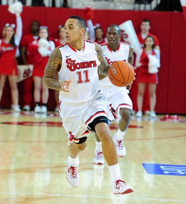 D'Angelo Harrison dribbles the ball during the first