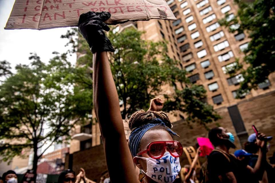 Protestors march in Manhattan during a rally calling