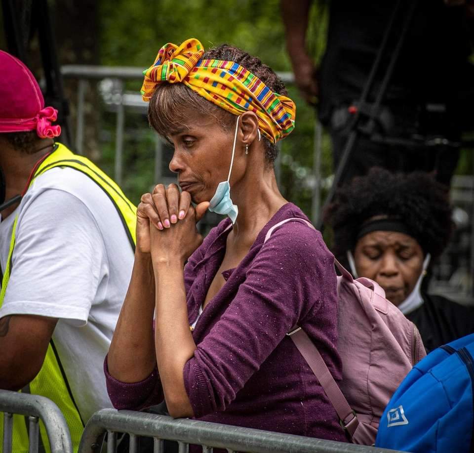 A woman appears to praying before the start