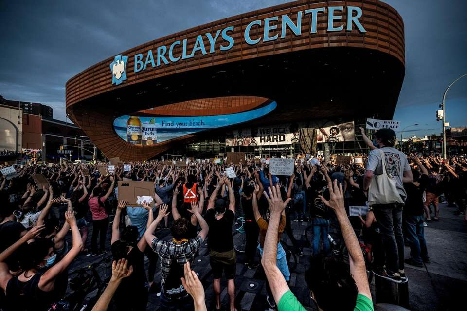 Protestors gather at Barclays Center in Brooklyn during