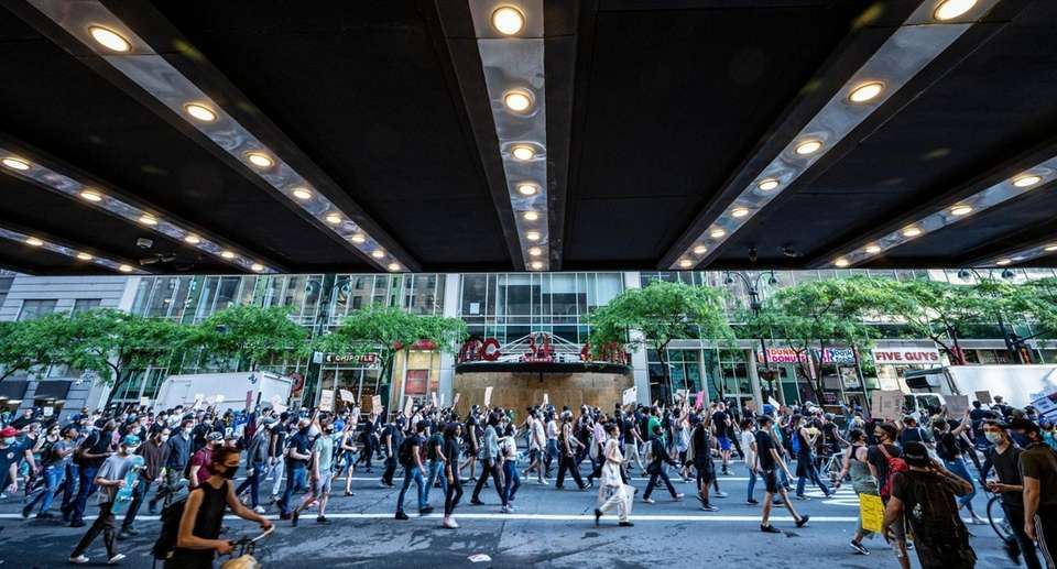 Protesters rallying through the streets of NYC in