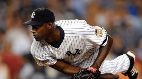 LaTroy Hawkins pitches in relief during his stint