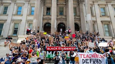 NYPD Out of Schools protesters march from the