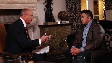 Dr. Phil McGraw, left, interviews Ronaiah Tuiasosopo --