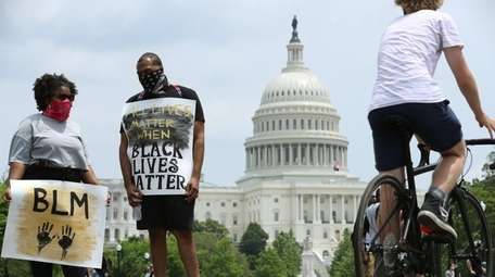 Demonstrators gather near the U.S. Capitol while protesting