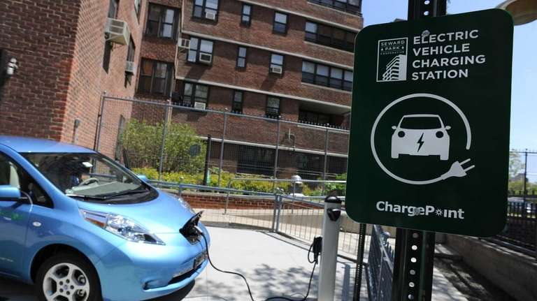 A Nissan Leaf electric car is plugged into