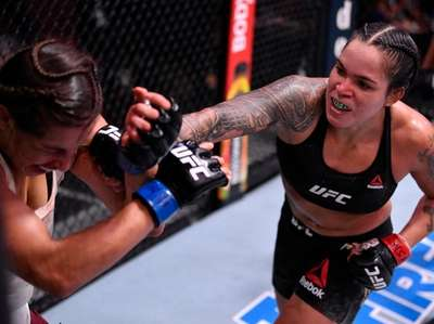 Amanda Nunes, right, punches Felicia Spencer in their