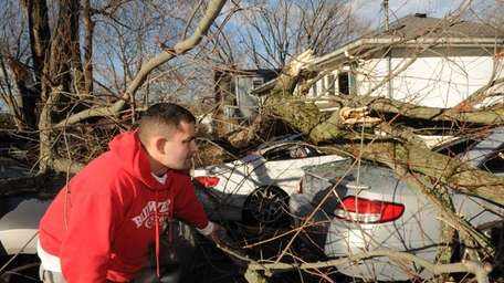 Joe Albini surveys damage to parked cars in