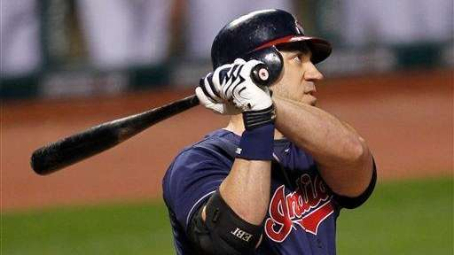 The Cleveland Indians' Travis Hafner watches his two-run