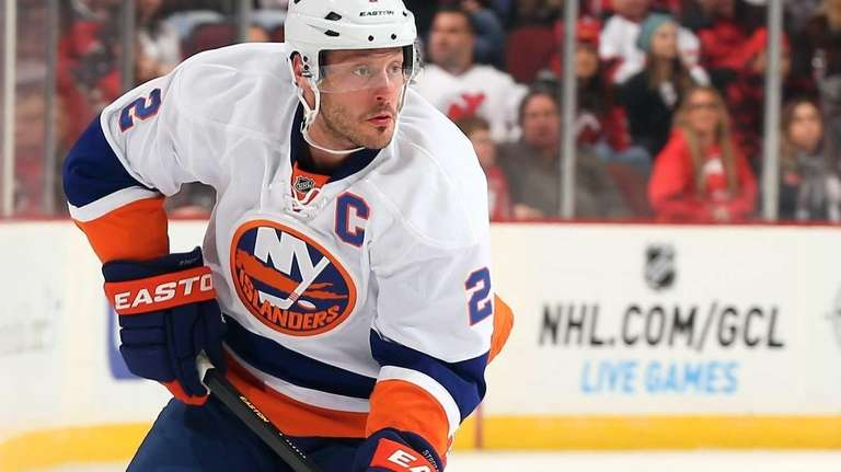 Mark Streit takes the puck in the first