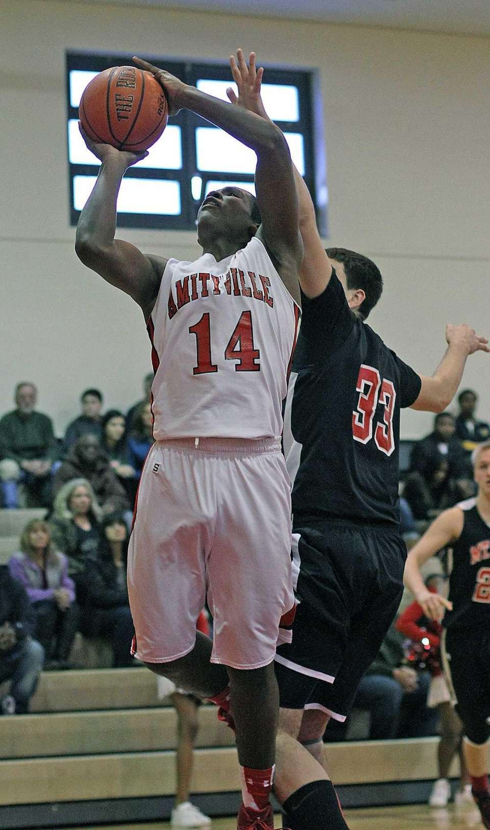 Amityville's Kavione Greene goes up for a shot