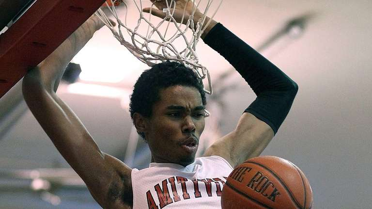 Amityville's Zack Tannis dunks the ball during a