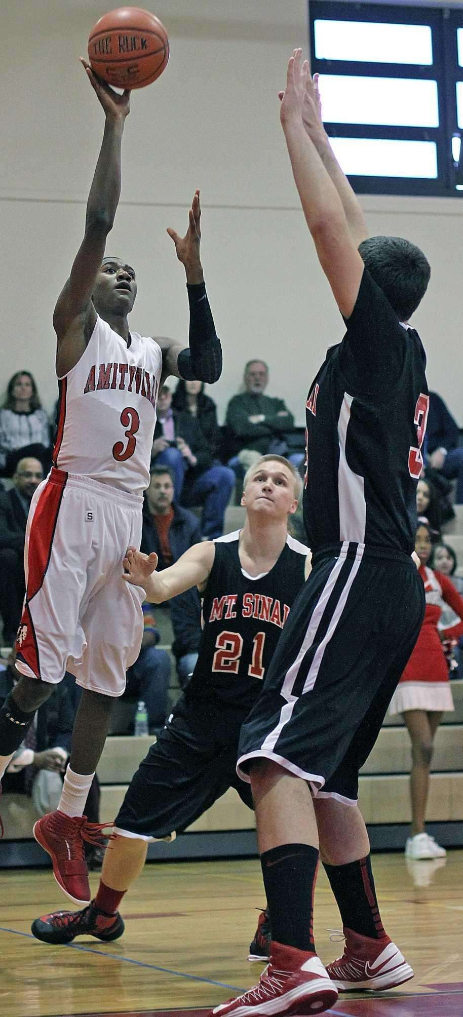 Amityville's Travis Dickerson shoots over Mt. Sinai's Michael