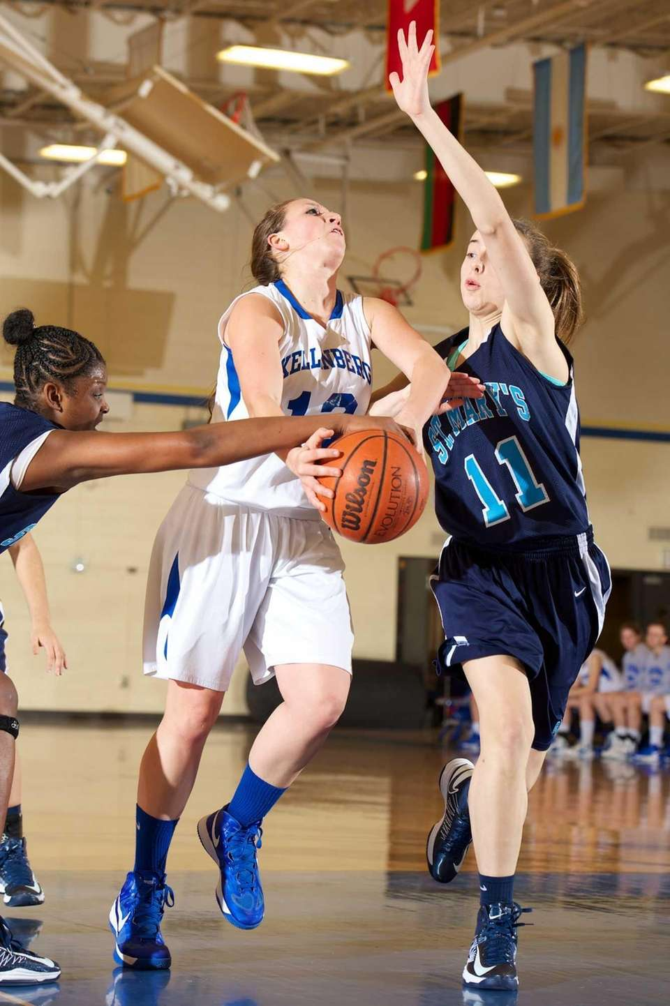 Kellenberg forward Amanda Crimarco (12) is fouled on