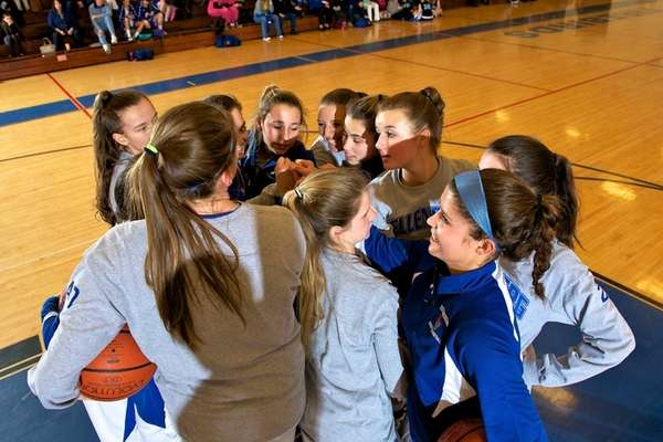 The Kellenberg girls basketball team huddles before the