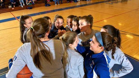 The Kellenberg girls basketball team huddles before the