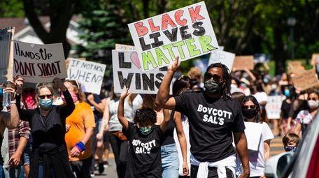 Rashid Johnson, right, from New York City, participates