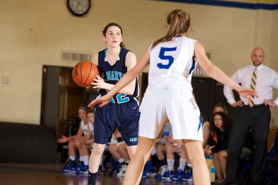St. Marys guard McKayla Hernandez looks for an