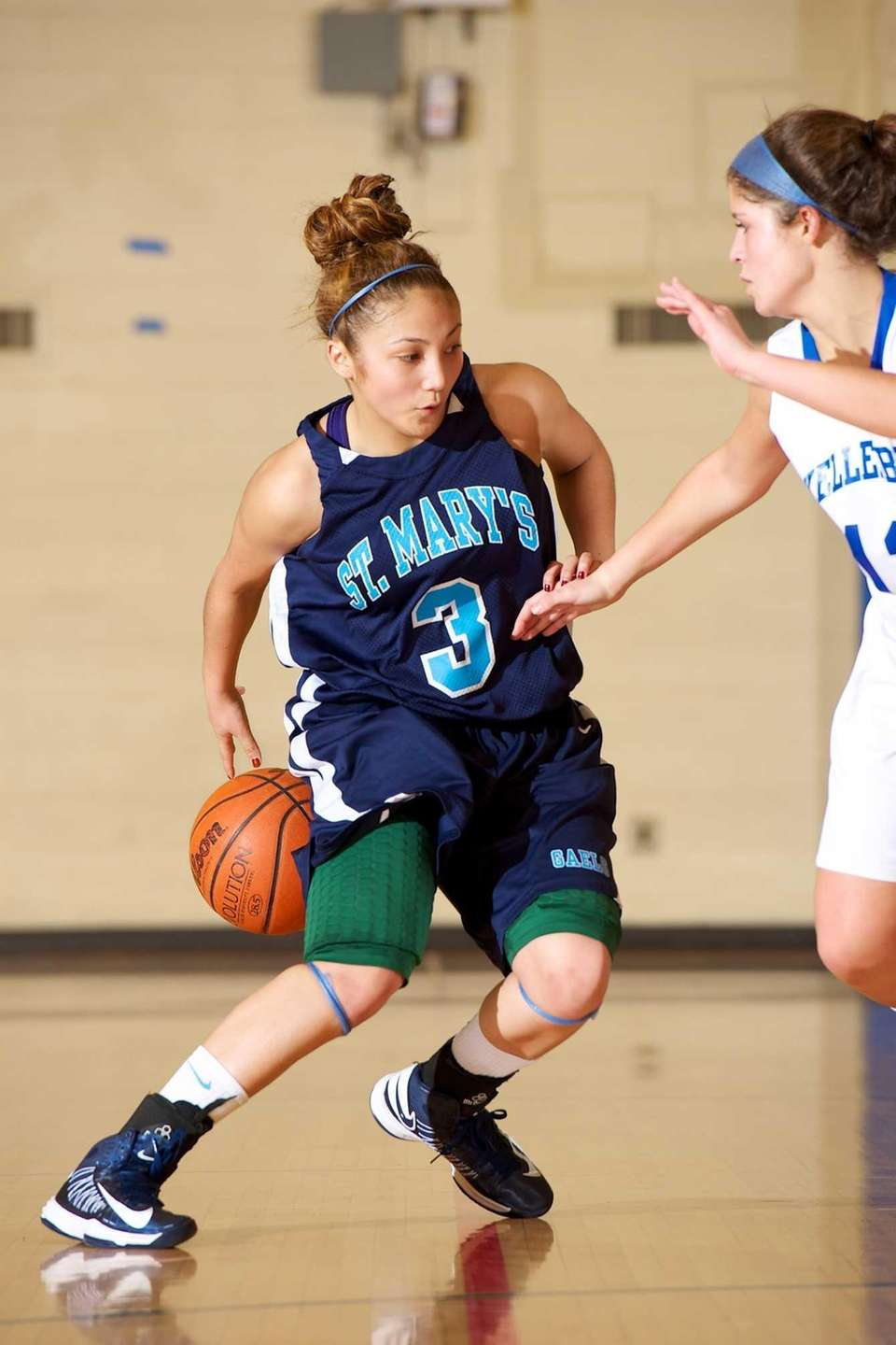 St. Marys guard Mei-Lyn Bautista attempts to dribble