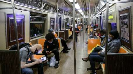 Commuters on Wednesday wear protective masks in a