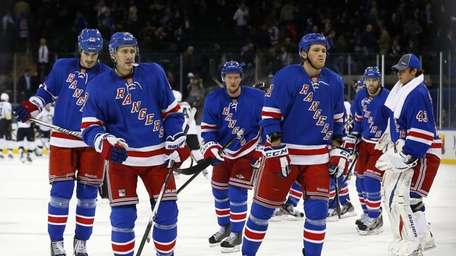 The Rangers skate off the ice after a