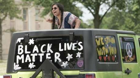 Protester Melanie Jackson along the Caravan for Justice
