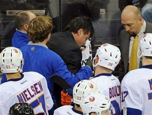 Jack Capuano leaves the bench after getting hit