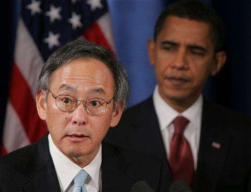 President Barack Obama listens as his Energy Secretary,