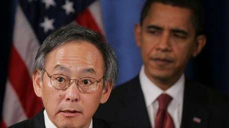 President Barack Obama listens as his Energy Secretary,