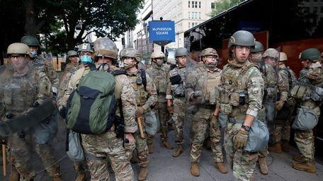 U.S. troops unload from buses on June 3